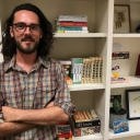 Photo of Caleb Johnson in his office.