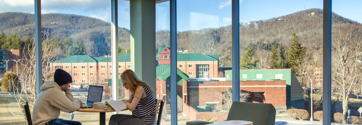 Students studying with howard's knob in the background